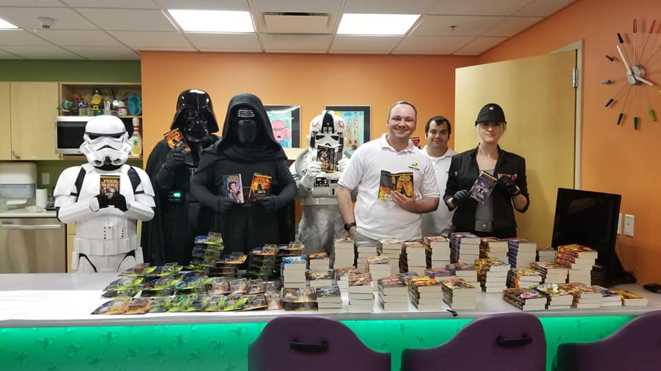 Twin Suns at a Children's Hospital with the Imperial 501st with all the books being donated